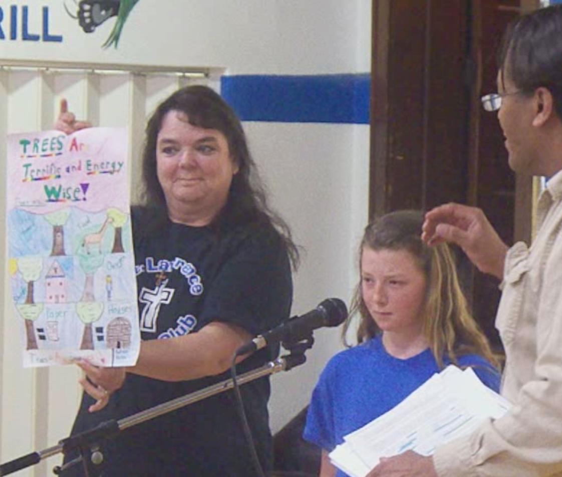 Jane Brack and Jeff Harris honor Madison Fulton in Lawrenceburg